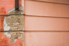 Ruined wall. With parallel lines a piece of drainpipe Royalty Free Stock Image