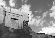Ruined Wall with Window. Derelict Building with Window, Sky and Clouds Royalty Free Stock Photo