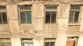 Ruined wall with windows of the building. bird`s eye view. Ruined wall with windows of an old building. bird`s eye view stock video