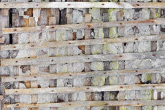 Ruined wall with wooden lattice - background Stock Photo