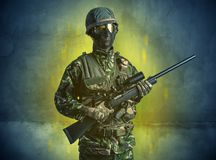 Ruined wallpaper with hazard soldier royalty free stock image