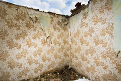 Ruined walls with retro wallpaper Stock Photos