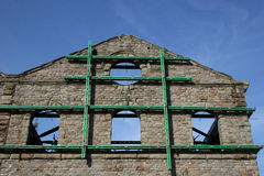 Ruined warehouse. Against blue sky Stock Photography