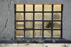 Ruined window. Window on the wall of ruined factory building royalty free stock image