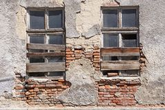 Ruined windows of an old building Stock Photo