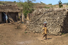 Ruined wood huts in Madagascar street Royalty Free Stock Photos