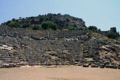 Ruines du théâtre chez Kaunos Image stock