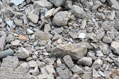Ruines matérielles de débris de béton et de blocaille de brique Images libres de droits