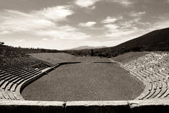 Ruines of stadium in the city of Ancient Messina, Peloponnes, Greece. Stadium in the city of Ancient Messina, Peloponnes, Greece, black and white stock image