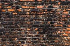 Ruinieren Sie die alte alte Backsteinmauer, die in Ayutthaya, Thailand gemasert wird Stockbild