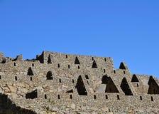 Ruinierte Häuser an der Machu Picchu verlorenen Stadt Lizenzfreie Stockfotografie