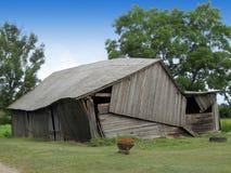 Ruinous barn. Half ruinous old wooden country farm barn Royalty Free Stock Photos