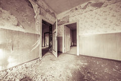 Ruinous empty room with old wallpapers Stock Photo