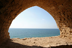 Ruins. Looking through an archway onto the Mediterranean Sea at Apollonia National Park in Herzliya, Israel Royalty Free Stock Photo