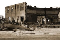 Ruins. Of a low rise building; monochrome in sepia; isolated against pure white; dirty white snow in foreground Stock Photography