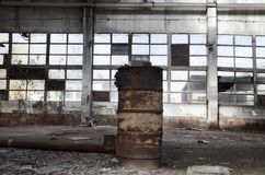 Ruins of abandoned factory or warehouse stock images