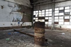 Ruins of abandoned factory or warehouse royalty free stock photo