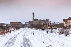 Ruins of abandoned factory in winter Royalty Free Stock Image