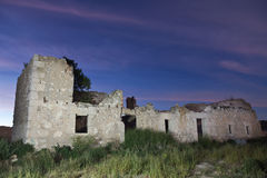 Ruins of an abandoned house at night Royalty Free Stock Photo