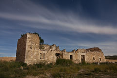 Ruins of an abandoned house at night Stock Photo
