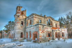 The ruins of an abandoned old castle. Old manor of an abandoned castle near the pine Royalty Free Stock Photo