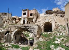Ruins of an abandoned old houses with arches on the top of Avanos hill. Turkey, Cappadocia stock image