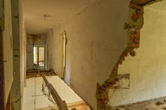 Remains of abandoned damaged and destroyed house interior with collapsed floor and wal. stock images