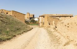 Ruins of abandoned rustic houses made of clay - suburb of Cetina. Town, province of Zaragoza, Aragon, Spain royalty free stock images