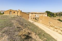 Ruins of abandoned rustic houses made of clay - suburb of Cetina. Town, province of Zaragoza, Aragon, Spain royalty free stock photo