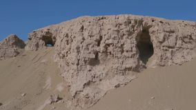 Ruins of an abandoned village town, Central Asia. Windy sunny day in the desert stock footage