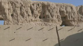 Ruins of an abandoned village town, Central Asia. Windy sunny day in the desert stock video footage