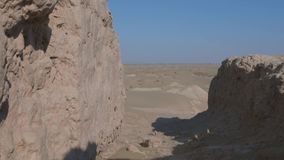 Ruins of an abandoned village town, Central Asia. Windy sunny day in the desert stock video