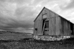Ruins Of Abandonment. Rustic Ruins Of An Old Abandoned Wooden Shed Decay In A Tasmanian (Australia) Farm Field, While Fierce Rain Clouds Form In The Skies Above Royalty Free Stock Photo