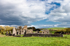 Ruins of the abbey in Ireland. Ruins of the abbey with blue sky in Ireland Royalty Free Stock Photo