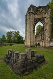 Tourists walking between the ruins of the abbey of stock photo