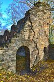 Ruins in the afternoon sun. On fallen leaves on the ground Royalty Free Stock Photo