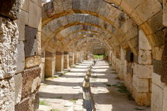 Ruins of agora in the city of Izmir. Ancient building with arche Stock Photos