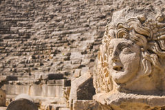 Ruins in ancient amphitheater of Myra Turkey. Antique stone head stock image