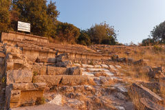 Ruins of ancient amphitheatre in Erytrai Ildiri Turkey Royalty Free Stock Photography