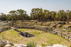 Ruins of the ancient amphitheatre in the historic centre of Syracusa Royalty Free Stock Photography