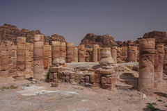 Ruins of the ancient Arabic city Petra, Jordan. Petra is a historical and archaeological city that is famous for its rock-cut architecture and water conduit Royalty Free Stock Photo