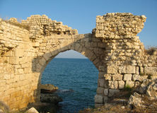 Ruins of ancient arch on the sea in Turkey Stock Images