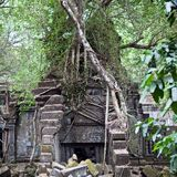 Ruins of ancient Beng Mealea Temple over jungle, Cambodia. Beng Mealea is a temple in the Angkor Wat style located 40 km east of the main group of temples at Stock Photo