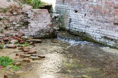The ruins of an ancient brick building flooded with water stock photos