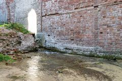 The ruins of an ancient brick building flooded with water.  royalty free stock images
