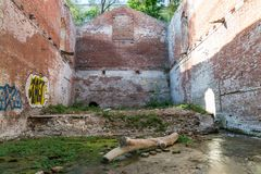 The ruins of an ancient brick building flooded with water royalty free stock photography