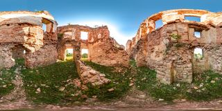 Ruins of ancient brick castle with blue sky sun green grass 3D spherical panorama with 360 degree viewing angle. Ready for virtual stock images