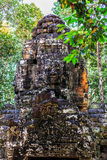 Ruins of ancient buddhist khmer temple. Giant stone faces of ancient buddhist khmer temple near Siem Reap, Cambodia Stock Photography