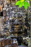 Ruins of ancient buddhist khmer temple. Giant stone faces of ancient buddhist khmer temple near Siem Reap, Cambodia Royalty Free Stock Photo