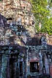 Ruins of ancient buddhist khmer temple near. Ancient stone door in ruins of  buddhist khmer temple near Siem Reap, Cambodia Stock Photography